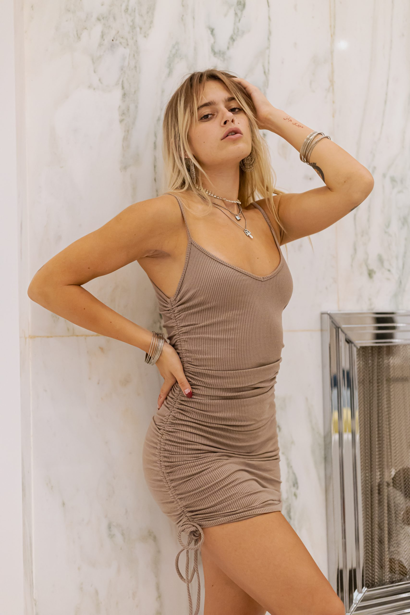 Youthful model with short scrunched dress